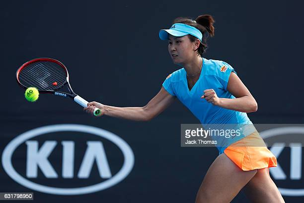 Shuai Peng of China plays a forehand in her first round match against Daria Kasatkina of Russia on day one of the 2017 Australian Open at Melbourne...