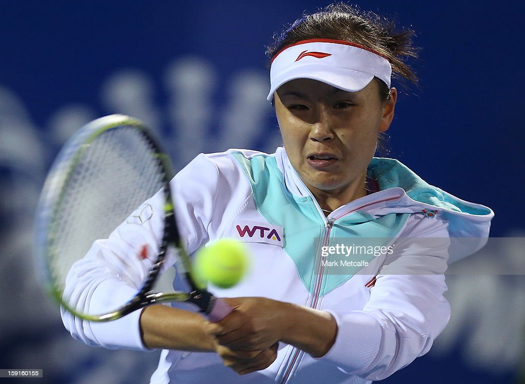Shuai Peng of China plays a forehand in her second round match against Monica Niculescu of Romania during day six of the Hobart International at Domain Tennis Centre on January 9, 2013 in Hobart, Australia.