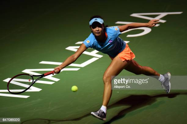 Shuai Peng of China plays a forehand shot to Magda Linette of Poland during a postponed match of Round 2 of the 2017 WTA Malaysian Open at the TPC on...
