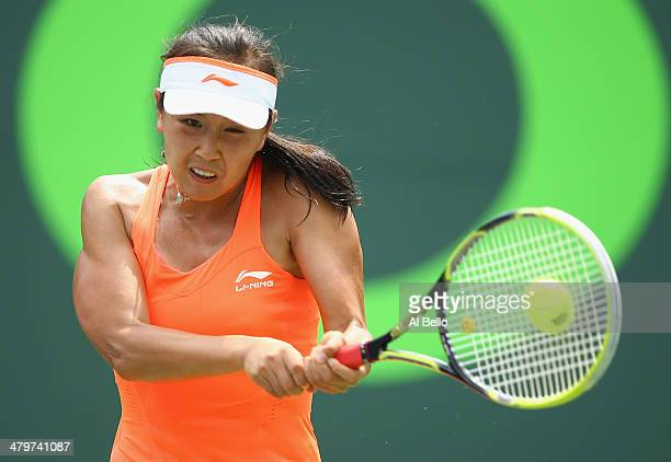 Shuai Peng of China returns a shot against Angelique Kerber of Germany after their match on day 4 of the Sony Open at Crandon Park Tennis Center on...