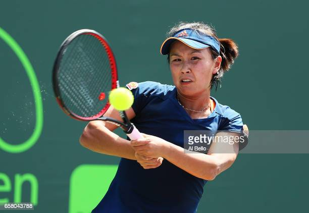 Shuai Peng of China returns a shot against Samantha Stosur of Australia during Day 7 of the Miami Open at Crandon Park Tennis Center on March 26 2017...
