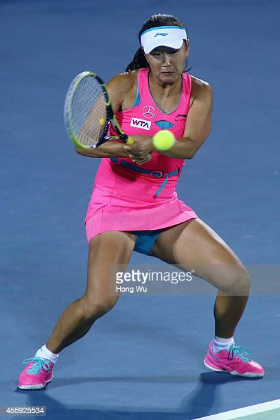 Shuai Peng of China returns a shot during her match against Mona Barthel of Germany during day two of the 2014 Dongfeng Motor Wuhan Open at Wuhan...