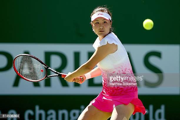 Shuai Peng of China returns a shot to Yulia Putintseva of Kazakhstan during the BNP Paribas Open at the Indian Wells Tennis Garden on March 9 2016 in...