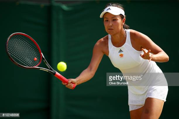 Shuai Peng of China returns the ball during the Ladies Singles third round match against Simona Halep of Romania on day five of the Wimbledon Lawn...