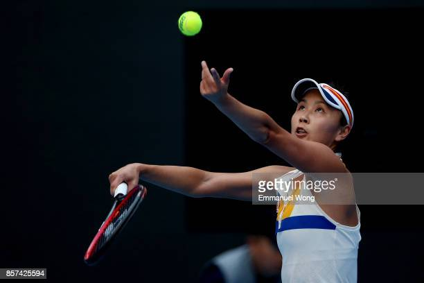 Shuai Peng of China serves against Monica Niculescu of Romania on day five of the 2017 China Open at the China National Tennis Centre on October 4...