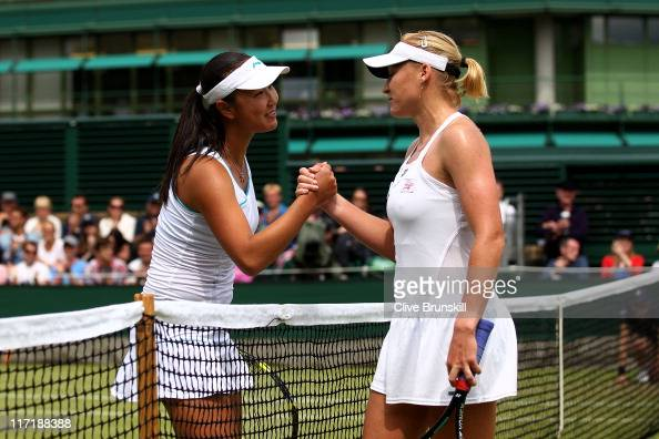 Shuai Peng of China shakes hands with Elena Baltacha of Great Britain after winning her second round match on Day Five of the Wimbledon Lawn Tennis...