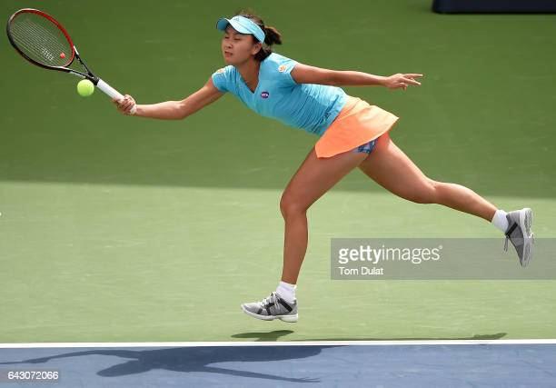 Shuai Peng of China straches to hit a forehand during her match against Lesia Tsurenko of Ukraine on day two of the WTA Dubai Duty Free Tennis...