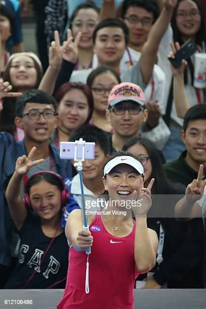 Shuai Peng of China takes a selfie with fans after wining the Women's singles first round match against Venus Williams of USA on day three of the...