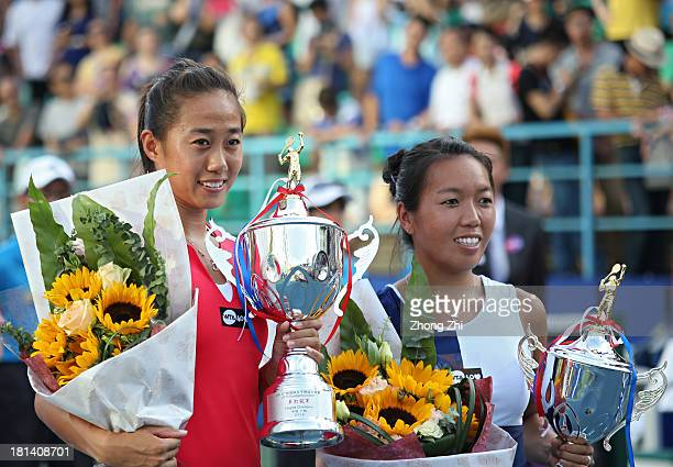 Shuai Zhang of China and Vania King of USA after the final match of WTA Guangzhou Open on September 21 2013 in Guangzhou China Shuai Zhang wins her...