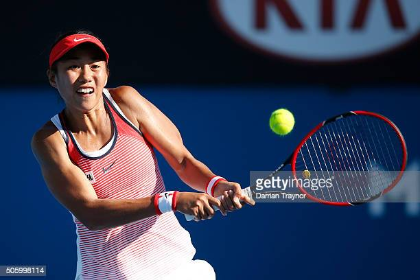 Shuai Zhang of China plays a backhand in her second round match against Alize Cornet of France during day four of the 2016 Australian Open at...