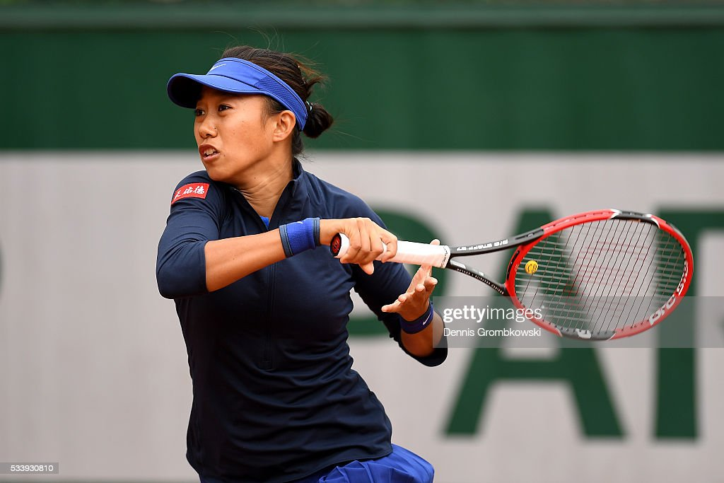 Shuai Zhang of China plays a forehand during the Women's Singles first round match against Galina Voskoboeva of Kazakhstan on day three of the 2016 French Open at Roland Garros on May 24, 2016 in Paris, France.