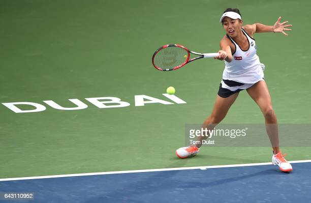 Shuai Zhang of China plays forehand during her match against Ana Konjuh of Croatia on day two of the WTA Dubai Duty Free Tennis Championship at the...