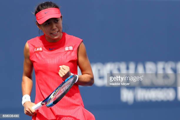 Shuai Zhang of China reacts during her match against Magda Linette of Poland during Day 6 of the Connecticut Open at Connecticut Tennis Center at...