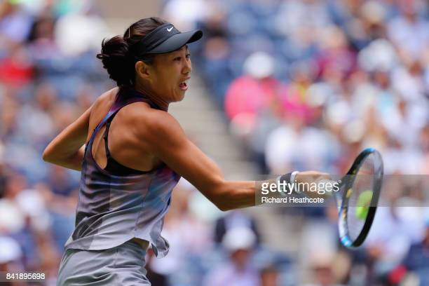 Shuai Zhang of China returns a shot against Karolina Pliskova of Czech Republic during their Women's Singles third round match on Day Six of the 2017...