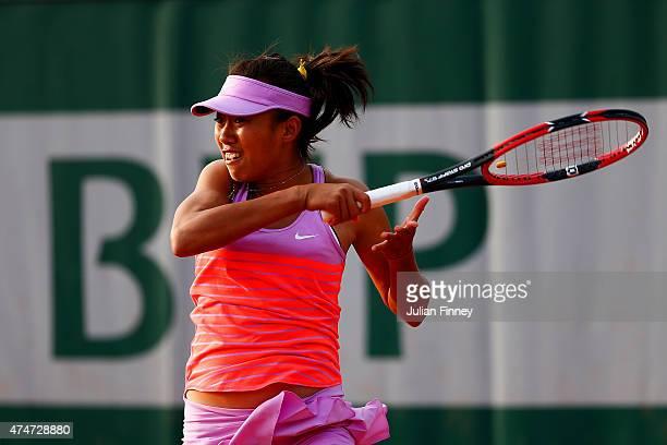 Shuai Zhang of China returns a shot during her women's singles match against Karolina Pliskova of Czech Republic on day two of the 2015 French Open...