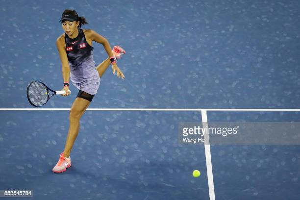 Shuai Zhang of China returns a shot during the match against Donna vekic of Croatia on Day 2 of 2017 Dongfeng Motor Wuhan Open at Optics Valley...