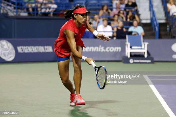 Shuai Zhang of China returns a shot to Petra Kvitova of Czech Republic during Day 4 of the Connecticut Open at Connecticut Tennis Center at Yale on...