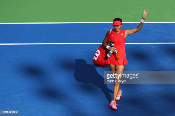 Shuai Zhang of China waves to fans after defeating Magda Linette of Poland during Day 6 of the Connecticut Open at Connecticut Tennis Center at Yale...