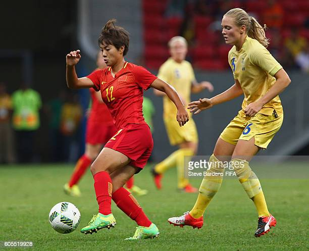 Shuang Wang of China PR shields the ball from Magdalena Eriksson of Sweden during the Women's First Round Group E match between China PR and Sweden...