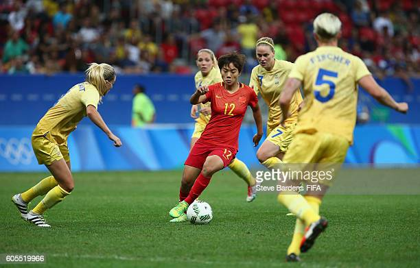 Shuang Wang of China PR takes on the Sweden defence during the Women's First Round Group E match between China PR and Sweden on Day 4 of the Rio 2016...