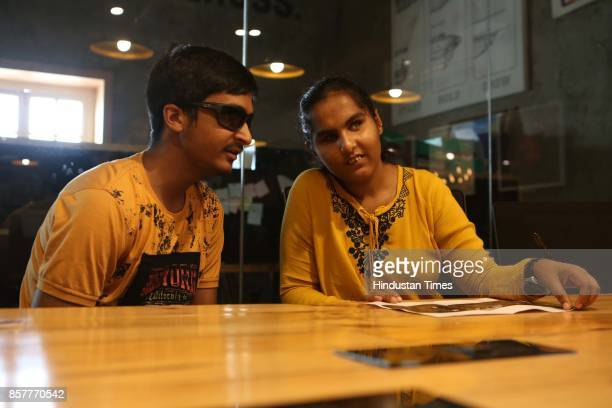 Shubham Singh a visuallyimpaired attendee a student of Class XII talks to another reader at the Human Library event at Connaught Place on June 18...