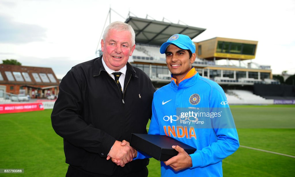 Shubman Gill of India U19s (R) is presented with the India player of the tournament award by David Graveney during the 5th Youth ODI match between England U19s and India Under 19s at The Cooper Associates County Ground on August 16, 2017 in Taunton, England.