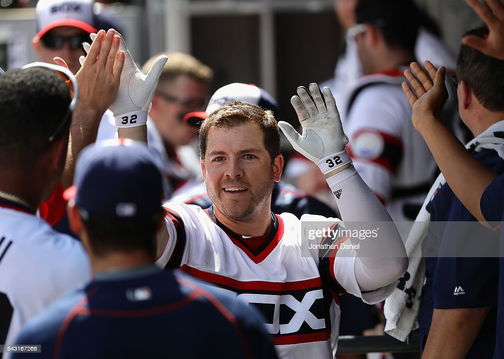 J.B. Shuck #20 of the Chicago White Sox is greeted by teammates in the dugout after hitting a solo home run in the 8th inning against the Toronto Blue Jays at U.S. Cellular Field on June 26, 2016 in Chicago, Illinois. The White Sox defeated the Blue Jays 5-2.