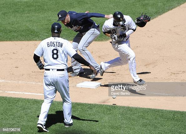 B Shuck of the Chicago White Sox is safe at first base with a bunt single as Freddie Freeman of the Atlanta Braves lose his glove during the seventh...