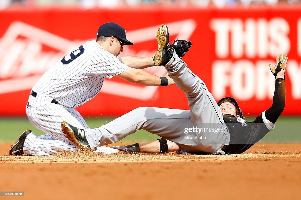 J.B. Shuck #20 of the Chicago White Sox is tagged out by <a gi-track='captionPersonalityLinkClicked' href=/galleries/search?phrase=Dustin+Ackley&family=editorial&specificpeople=4352278 ng-click='$event.stopPropagation()'>Dustin Ackley</a> #29 of the New York Yankees trying to steal second base in the second inning at Yankee Stadium on September 27, 2015 in the Bronx borough of New York City.