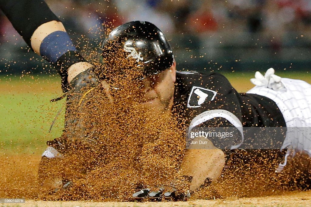 B Shuck of the Chicago White Sox is tagged out by Mike Zunino of the Seattle Mariners after a run down following a pickoff attempt during the third...