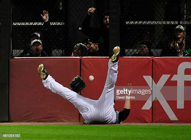 B Shuck of the Chicago White Sox makes a catch on Dixon Machado of the Detroit Tigers during the seventh inning on October 2 2015 at US Cellular...