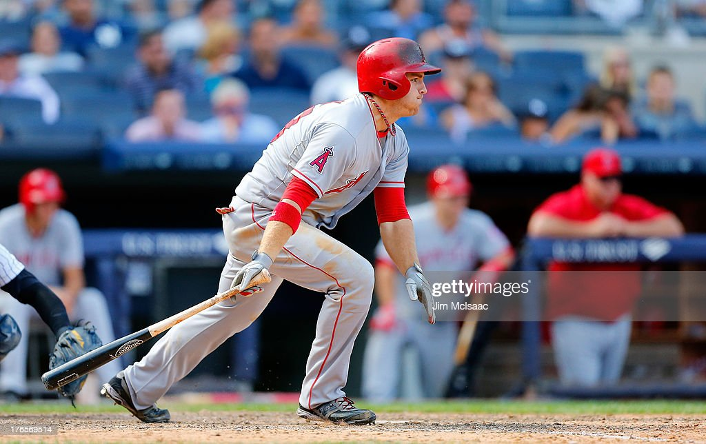 J.B. Shuck #39 of the Los Angeles Angels of Anaheim knocks in a run in the eighth inning on a base hit against the New York Yankees at Yankee Stadium on August 15, 2013 in the Bronx borough of New York City.