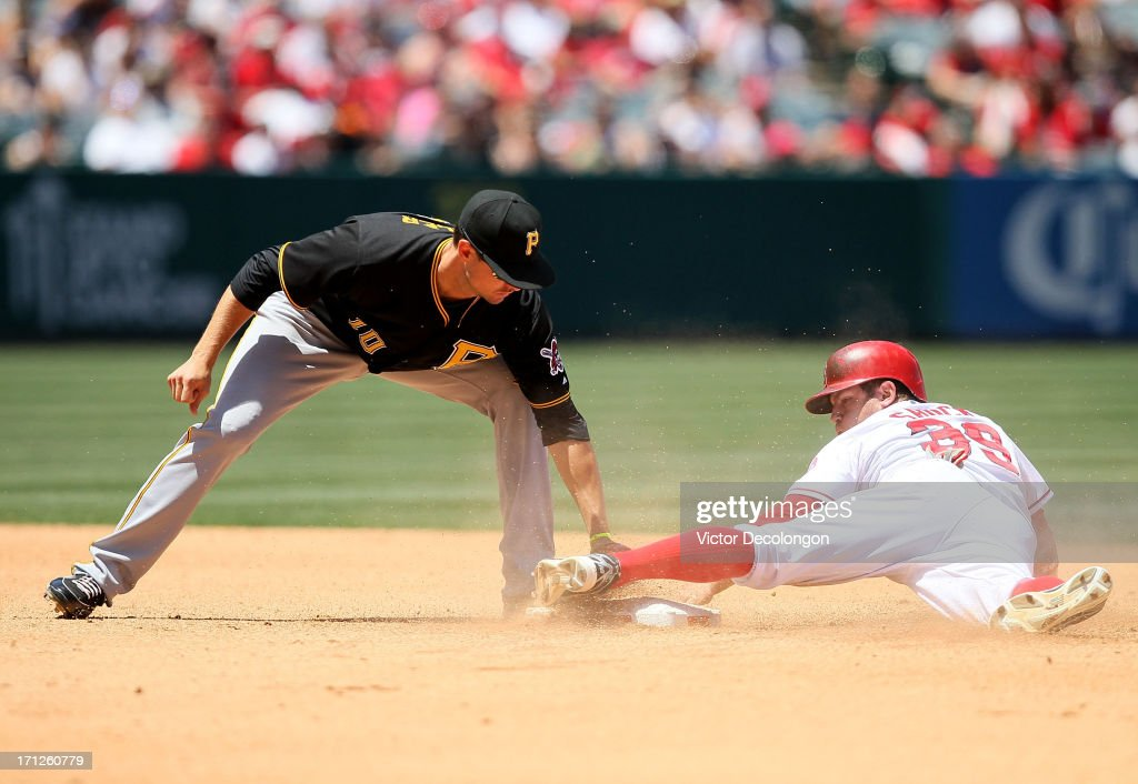 J.B. Shuck #39 of the Los Angeles Angels of Anaheim steals second base in the fourth inning as Jody Mercer #10 of the Pittsburgh Pirates is late with the tag during the MLB game at Angel Stadium of Anaheim on June 23, 2013 in Anaheim, California. The Pirates defeated the Angels 10-9 in ten innings.