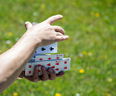 shuffling cards, close-up of hands