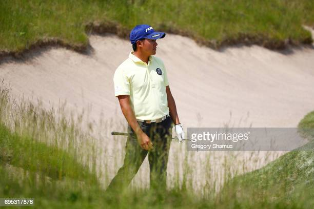 Shugo Imahira of Japan plays a shot during a practice round prior to the 2017 US Open at Erin Hills on June 12 2017 in Hartford Wisconsin