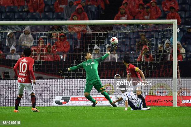 Shuhei Akasaki of Gamba Osaka scores his side's second goal during the JLeague J1 match between Urawa Red Diamonds and Gamba Osaka at Saitama Stadium...
