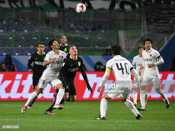 Shuhei Akasaki of Kashima and Mateus Uribe of Atletico Nacional compete for the ball during the FIFA Club World Cup Semi Final between Atletico...