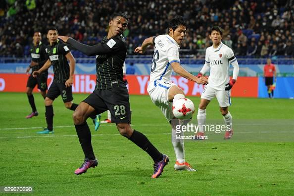 Shuhei Akasaki of Kashima and Orlando Berrio of Atletico Nacional compete for the ball during the FIFA Club World Cup Semi Final between Atletico...