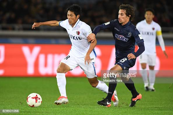 Shuhei Akasaki of Kashima Antlers and Albert Riera of Auckland City compete for the ball during the FIFA Club World Cup Playoff for Quarter Final...