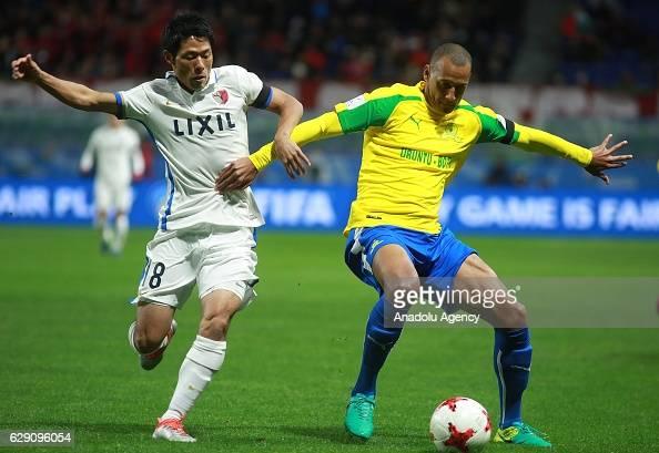Shuhei Akasaki of Kashima Antlers and Arendse Wayne of Mamelodi Sundowns in action during the second round match between Mamelodi Sundowns and...