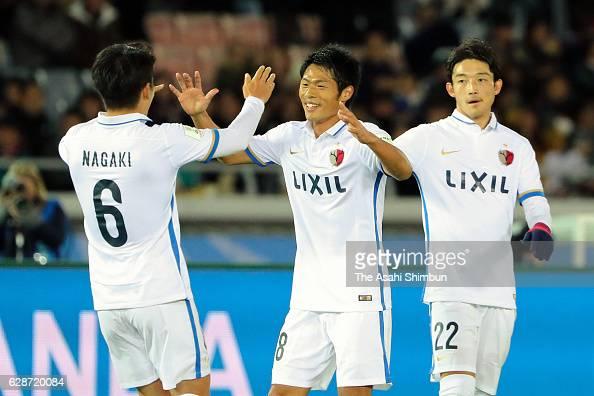Shuhei Akasaki of Kashima Antlers celebrates scoring his team's first goal with his team mates Ryota Nagaki and Daigo Nishi during the FIFA Club...