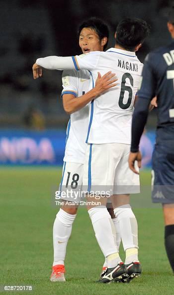 Shuhei Akasaki of Kashima Antlers celebrates scoring his team's first goal with his team mate Ryota Nagaki during the FIFA Club World Cup Playoff for...