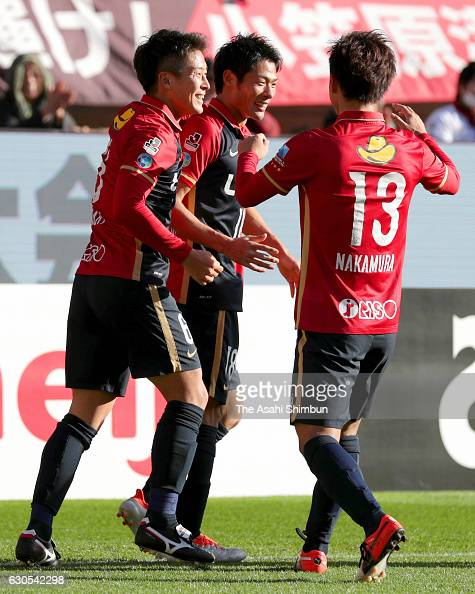 Shuhei Akasaki of Kashima Antlers celebrates scoring the opening goal with his team mates during the 96th Emperor's Cup quarter final match between...