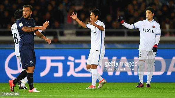 Shuhei Akasaki of Kashima Antlers celebrates with team mates as he scores their first goal during the FIFA Club World Cup Playoff for Quarter Final...