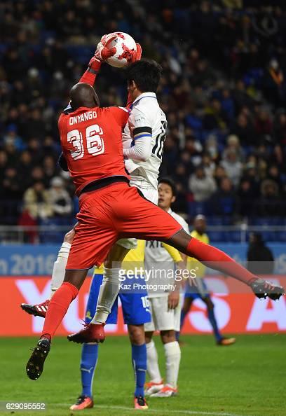 Shuhei Akasaki of Kashima Antlers challenges Denis Onyango of Mamelodi Sundowns during the FIFA World Cup Quarter Final match between Mamelodi...