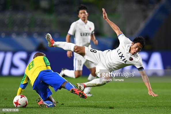 Shuhei Akasaki of Kashima Antlers is tackled by Hlompho Kekana of Mamelodi Sundowns during the FIFA World Cup Quarter Final match between Mamelodi...
