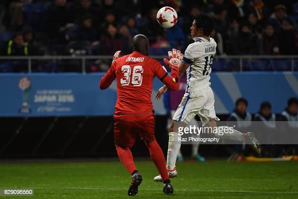 Shuhei Akasaki of Kashima Antlers keeps the ball under the pressure from Denis Onyango of Mamelodi Sundowns during the FIFA World Cup Quarter Final...