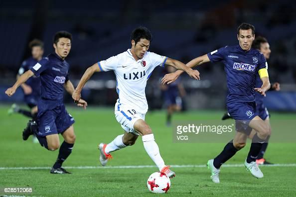 Shuhei Akasaki of Kashima Antlers kicks the ball during the first round match of FIFA Club World Cup Playoff for Quarter Final match between Kashima...