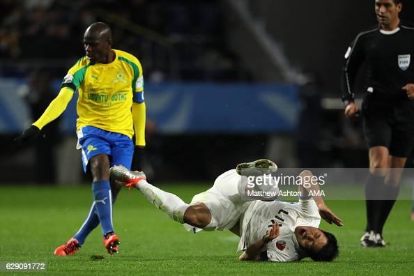 Shuhei Akasaki of Kashima Antlers reacts to a tackle by Hlompho Kekana of Mamelodi Sundowns during the FIFA Club World Cup Quarter Final match...