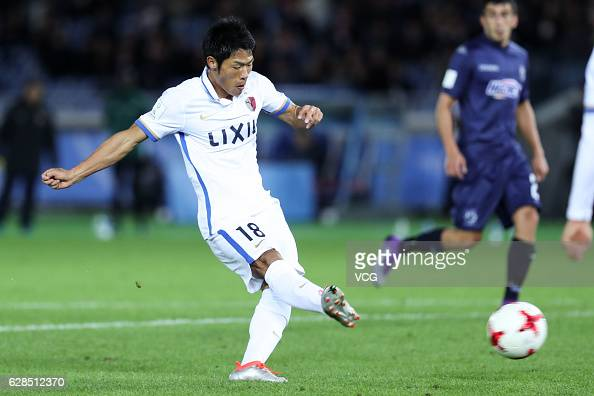 Shuhei Akasaki of Kashima Antlers shots the ball during the first round match of FIFA Club World Cup Playoff for Quarter Final match between Kashima...